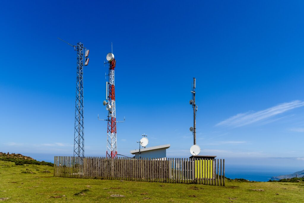 Telecommunication and telephone antenna in green landscape